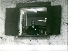 Georges Bidault looking through the window.  - 1963