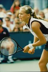 Anna Kournikova on his way to victory against Silvia Farina in the US Open