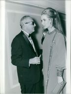 Darryl Zanuck standing together with a woman.