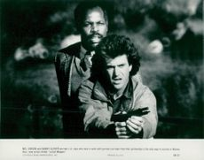 "Danny Glover and Mel Gibson in the movie ""Deadly Weapons"""