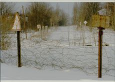 Signs and barbed wire warn about the forbidden zone at Chernobyl.
