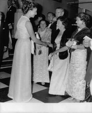 Princess Alexandra handshake with a woman, smiling.