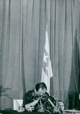 A General got saddened, during a press conference, in Vietnam.