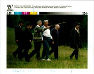 National Lottery: Prime Minister John Major points the way to President Yeltsin in a field near Chequers today.