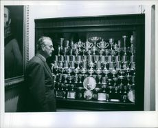 Louis Mountbatten, 1st Earl Mountbatten of Burma photographed beside a collection of trophies.