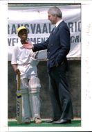 National Lottery: British Prime Minister john Major talks to a young cricketer.