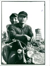 Two f.d. Saigon soldiers on a Honda motorcycle