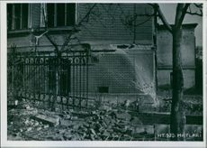 Destruction in front of a building in Hungary during World War II.
