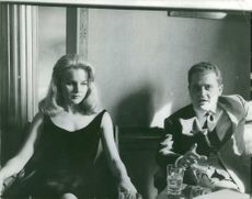 Carroll Baker sitting with her husband Jack Garfein beside her.