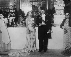 Queen Farida and King Farouk of Egypt on a birthday party - 2 February 1938