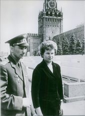 Valentina Tereshkova is with a military person.