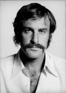 Portrait of tennis player John Newcombe