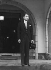Prince Akihito at his residence prepares to leave for his wedding.