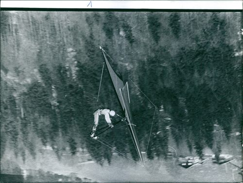 A photo of a man riding in a parachute.