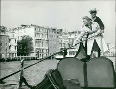 Michelle Morgan rowing with a man on a boat