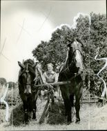 Actor Nelson Eddy works at his ranch