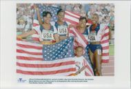 US team teams Rochelle Stevens, Kim Graham, Maicel Malone and Jearl Miles posing with the American flag after gold at 4x400m during the Atlanta Olympic Games in 1996
