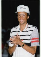 "American tennis player Arthur Ashe at a charity event in favor of ""Safe Passage"""