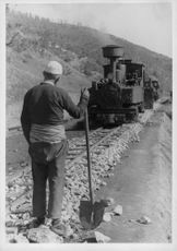A worker laying railway line, 1943.