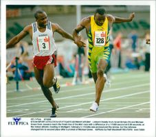 Linford Christie and Michael Green cross the finish line at 60m in Stuttgart
