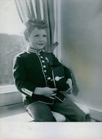 Prince Carl XVI Gustaf wearing uniform and smiling. 1952.