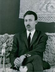 1967 Houari Boumediene sitting on couch and facing camera.