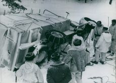 Finnish-Russian war of 1939-40  Danish ambulance turned turtle as a result of Russian bombing seen by Finnish civilian during wartime.