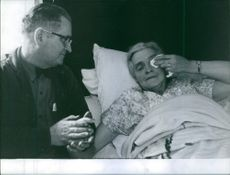 Oliver Winfield Powers holding hand of Ida Melinda Ford, lying in bed.