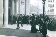 Makarios III being surrounded by people.