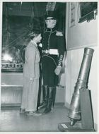 The Maritime Museum: A boy is watching a uniform on a doll