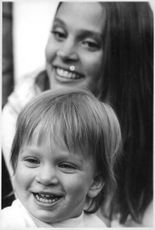 Leigh Taylor-Young with a kid.