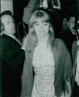 Jane Asher looking down as she walked towards the camera.