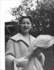 Michiko Shōda holding a bouquet of flowers