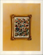 A beautiful picture frame hanging on the wall.