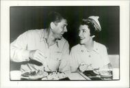 "Ronald Reagan and his wife Nancy eat lunch during the ""Hellcats of the Pacifix"" record at the San Diego Naval Training Center"