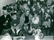 Queen Paola of Belgium with many children and other people.