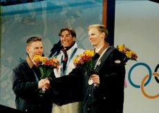 Silver, gold and bronze medalists in cockpit, Janne Iahtela, Finland, Jonny Moseley, USA, and Sami Mustonen, Finland.