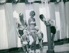 Prince Johann Georg bathing under shower with family. 1968