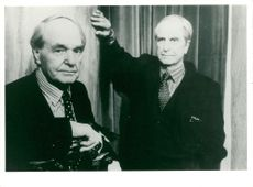Sculptor Henry Moore next to his wax portrait at Madame Tussauds