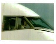 Aircraft Skyjack All Nippon 747 1995: This is a TV image showing the face of a person in the cockpit of a hijacked.