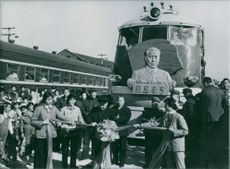 """The """"Chou En-Lai Special""""  Inaugurating the Chou En-Lai Special"""": Chinese Politburo member Su Chen-hua cuts the ribbon at a special ceremony to mark the launching of a new railway locomotive named after the late Chinese Premier Chou En-lai."""