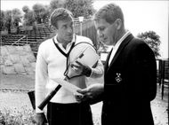 Tennis player John Newcombe together with Mats Hasselqvist