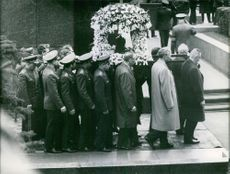 People at the funeral ceremony.