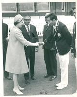 Thw Queen shaking hands with the Nawab.