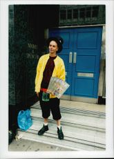 Boy stands and sells the newspaper The big issue.