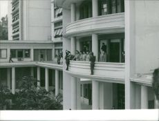 Military officials standing on balcony while cameramen are standing on the outer edge to get good pictures in Algeria.  - May 1961