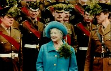 Queen Elizabeth is greeted at a military facility during her state visit to Berlin.