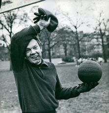 A MAN WITH A BALL IN HAND