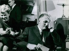 Photograph of Pierre Marcilhacy with his hand on his head.