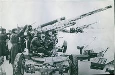 Russian aircraft gun in position. An A.A. Battery which brought down twelve fascist planes. 1943